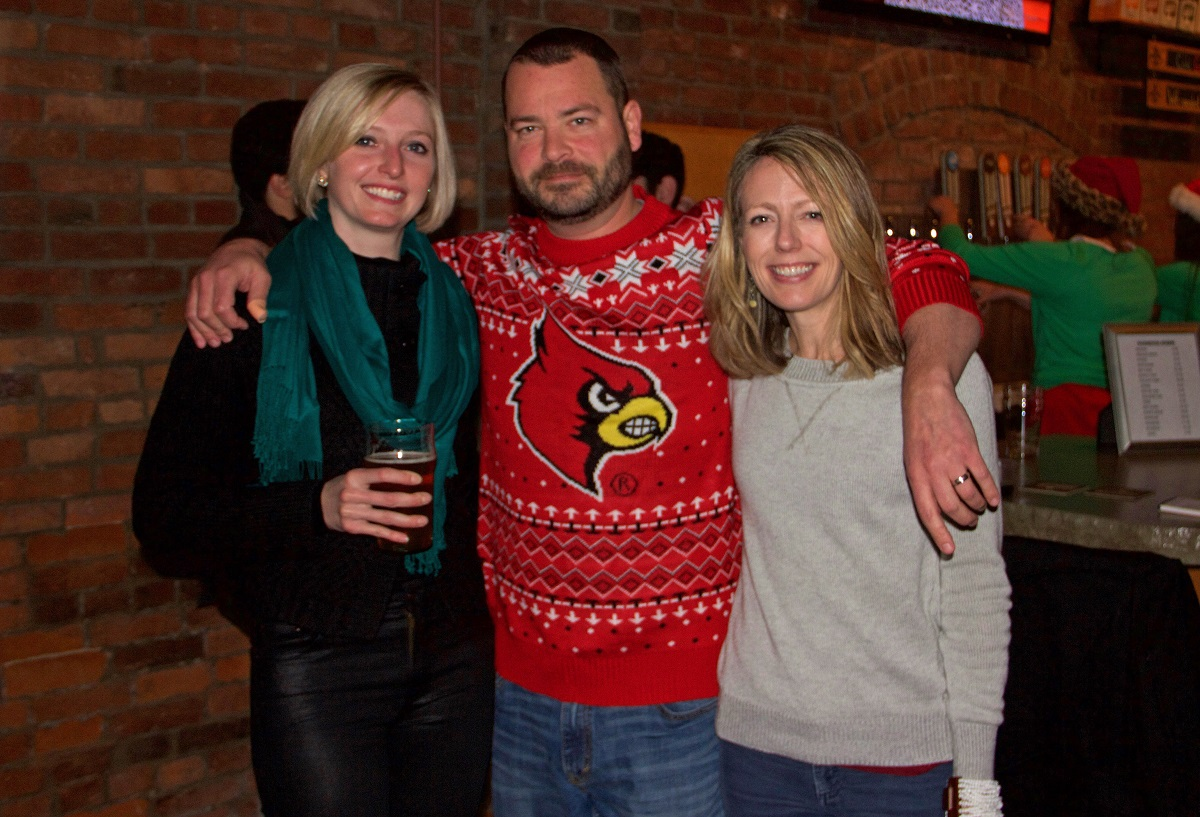 Maggie Hoy, Ryan and Beth Thiel. Rayan celebrates Lamar Jackson's Heisman Award AND keeps with the spirit of the party!