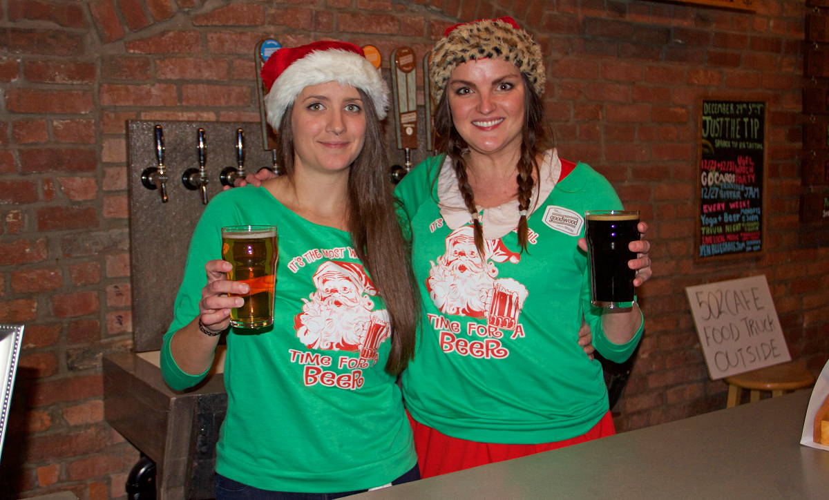 Christy Alexander and Paige Peterson serve only the best - ESPECIALLY at the Christmas party