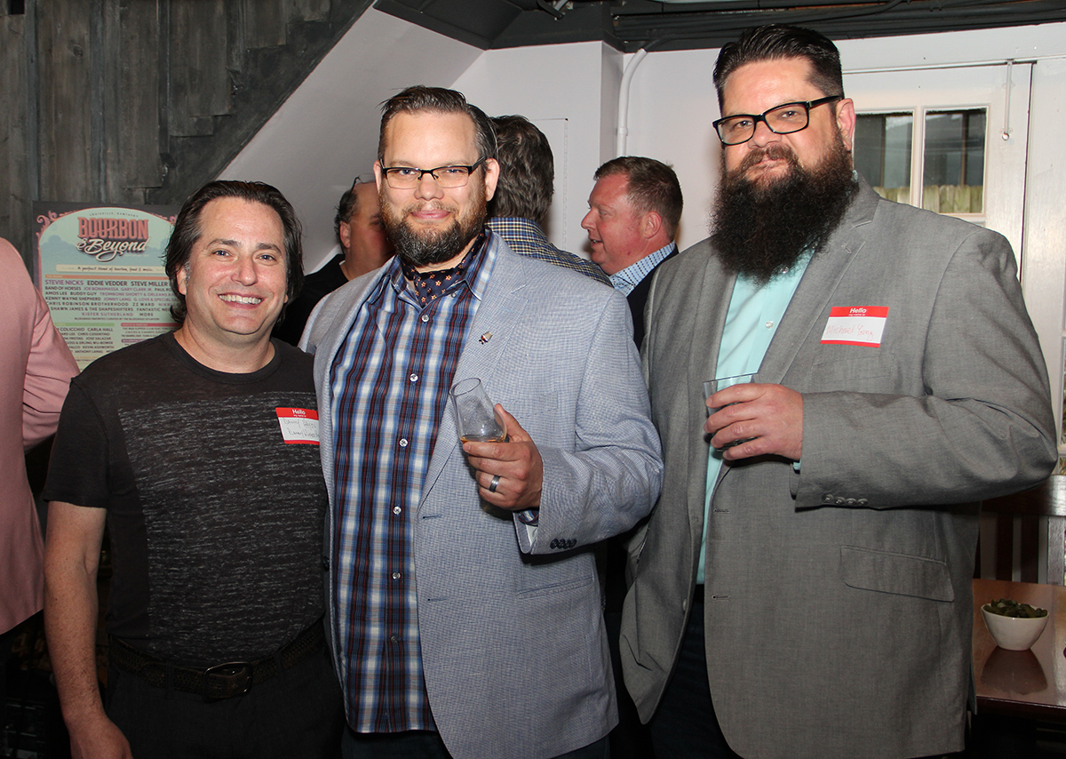 Danny Hayes CEO of Danny Wimmer Presents, FredMinnick, Bourbon Writer and curator, and Michael Young with the Courier Journal